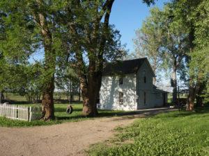 Farmhouse through the trees